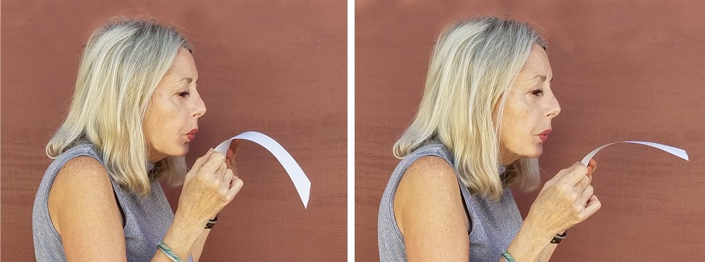 Blowing over a piece of paper to demonstrate lift